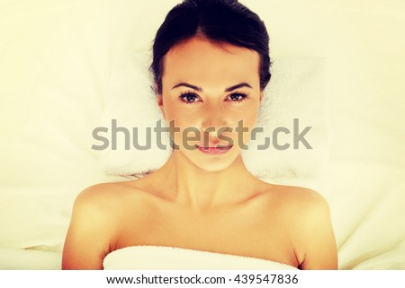 Woman lying on a towel in spa