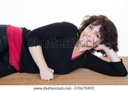 Woman lying on carpet thinking against white background