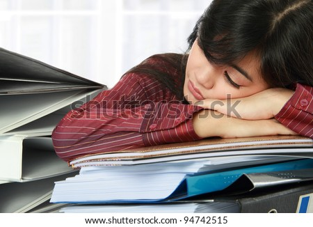 woman lying on her paperwork. feeling stress concept - stock photo