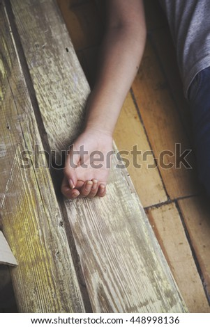 woman lying on the wooden floor. Empty room