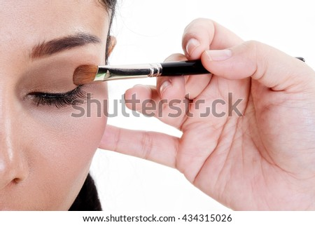 Woman Make-up Applying closeup.Cosmetic Eyeshadows.Makeup. - stock photo