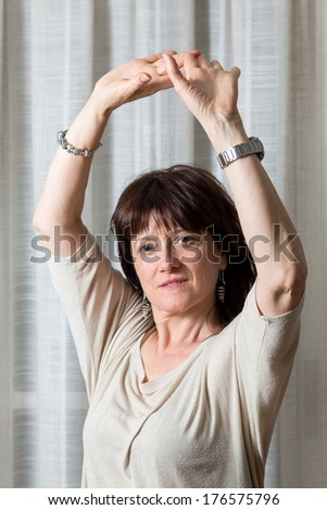 woman makes a gesture with his arms dance