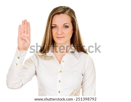 Woman makes hand sign salute. Four fingers up and thumbs bended. Isolated. Sign of demonstrators. - stock photo