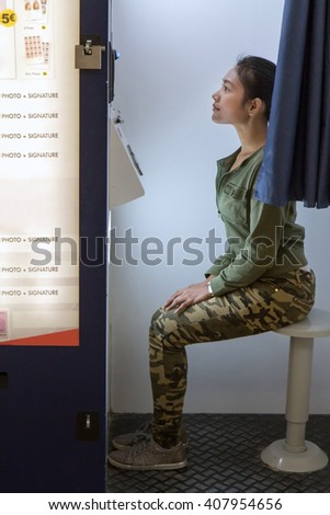 woman makes the portrait inside photo booth - stock photo