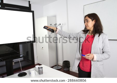 Woman making a presentation on a monitor screen blank