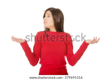 Woman making a scale with her arms. - stock photo