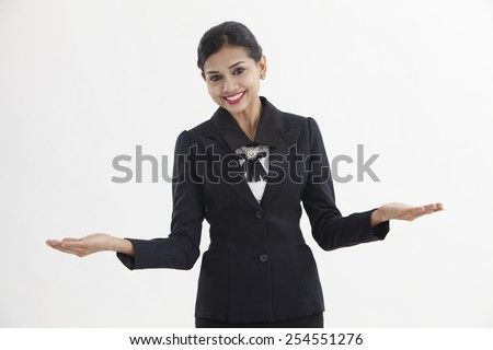 woman making a scale with her arms wide open, isolated in a white background - stock photo