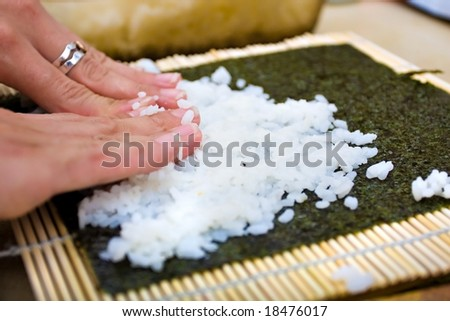 woman making california roll close-up - stock photo