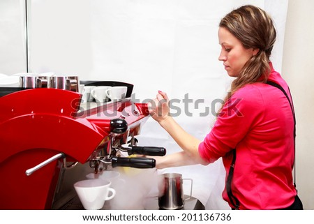 woman making cappuccino