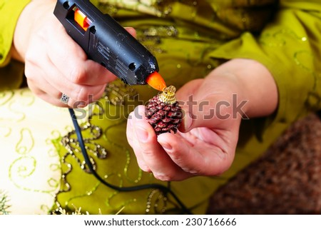 Woman making christmas advent wreath, close up - stock photo