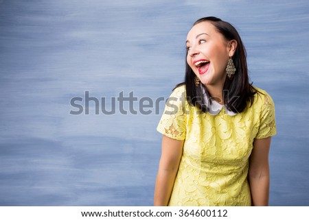 Woman making funny facial expression  - stock photo