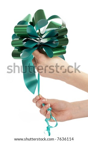 woman making green bow - stock photo