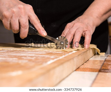 Woman making homemade pasta in the kitchen