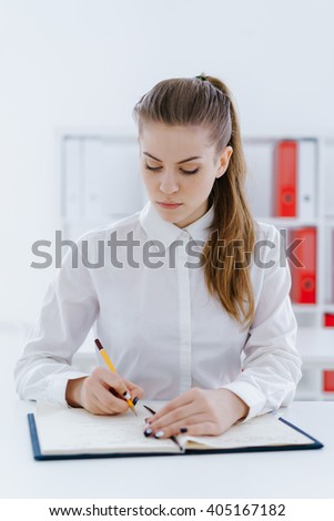 Woman making journal entries