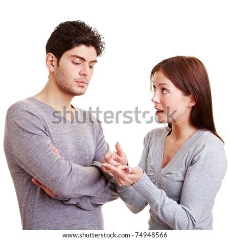 Woman making many reproaches to her frustrated man - stock photo