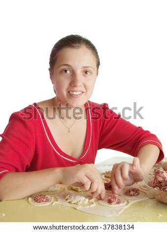 Woman making meat dumplings from stuffing and dough - stock photo