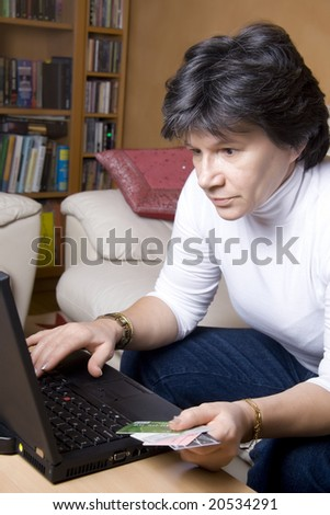 Woman making online purchase, can be used for e-commerce concept - stock photo