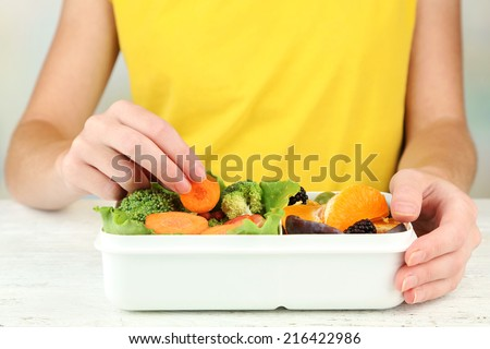 Woman making tasty vegetarian lunch, close up - stock photo