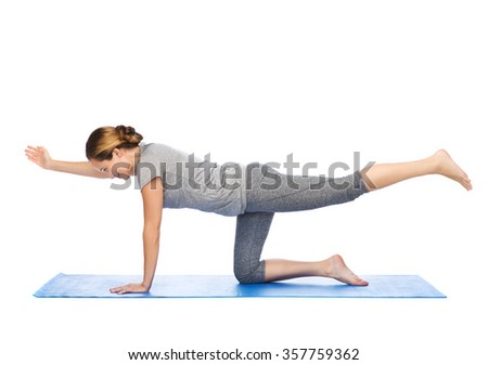 Beautiful sporty fit yogini woman practices stock photo for Table yoga pose