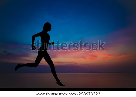 Woman making yoga on the beach in sunset