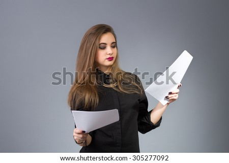 Woman manager - businesswoman holding papers in hands - stock photo