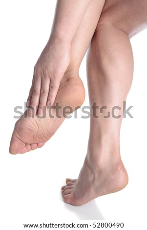 Woman massaging aching feet   over white - stock photo