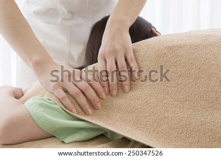 Woman massaging an upper arm