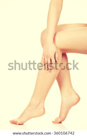 Woman massaging her legs.