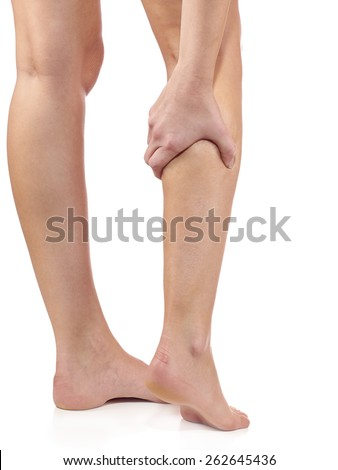 Woman massaging her painful leg calf. Joint injury or disease concept. - stock photo