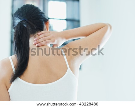woman massaging neck. Rear view, copy space - stock photo