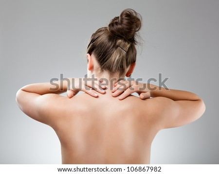Woman massaging pain back - stock photo
