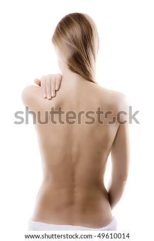 Woman massaging pain back - stock photo