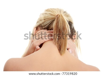 Woman massaging pain in her neck, isolated on white