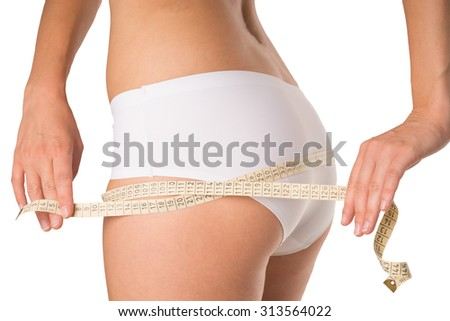 Woman measure the circumference of the buttocks / circumference of the buttocks - stock photo