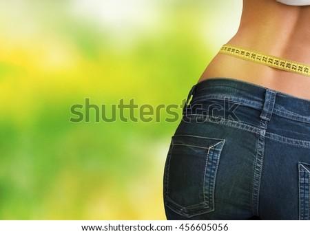 Woman measuring body. - stock photo