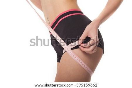 Woman measuring her slim body on white background - stock photo