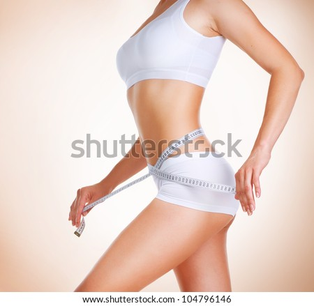 Woman measuring her waistline. Diet. Perfect Slim Body - stock photo