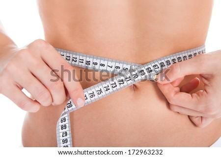 Woman Measuring Perfect Shape Of Beautiful Body - stock photo