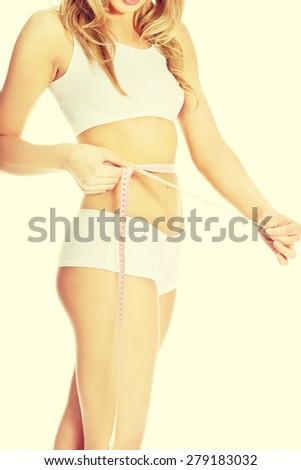 Woman measuring perfect shape of beautiful body. - stock photo