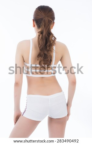 Woman measuring perfect shape of beautiful hips. Healthy lifestyles concept - stock photo
