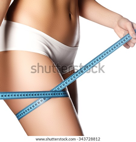 Woman measuring perfect shape of beautiful hips.Healthy lifestyles concept. Woman body part is being measured. Spa beauty part of body.Healthy lifestyle, diet and fitness. Perfect waist, butt and legs - stock photo