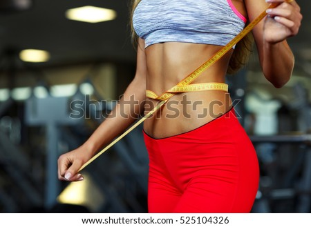 Woman measuring perfect shape of beautiful waist, healthy lifestyles concept