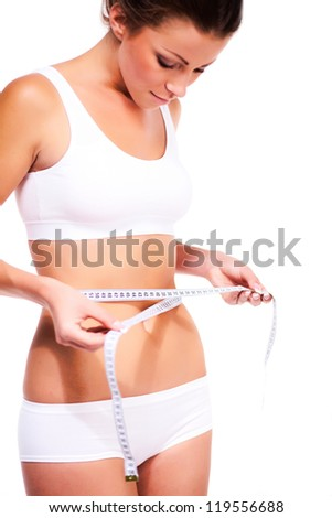 Woman measuring toned waist