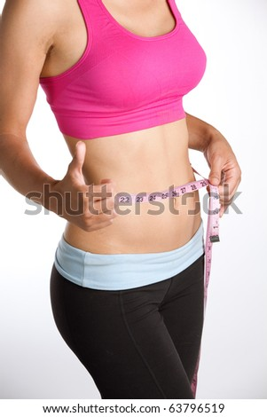 Woman Measuring Waist Thumbs Up - stock photo
