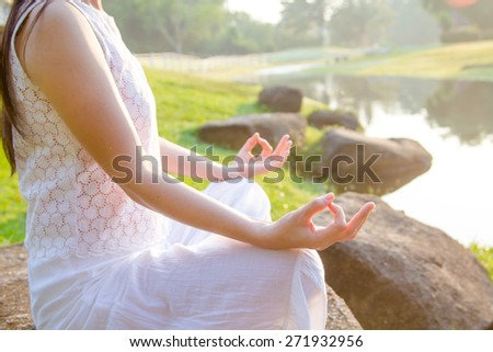 woman meditating in a yoga on nature - stock photo