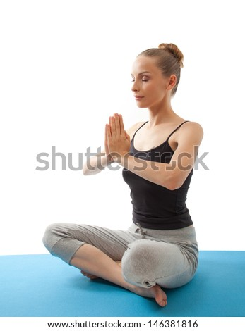 woman meditating in pose of lotus on white background
