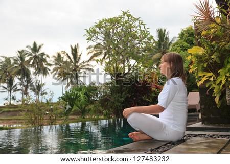 woman meditation in  tropical resort - stock photo