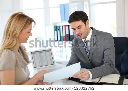 Woman meeting banker to set up her own business - stock photo