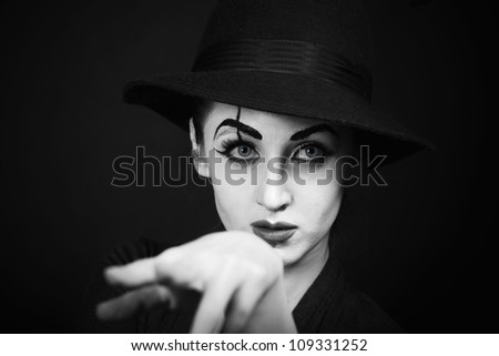 woman mime with theatrical makeup on black background - stock photo
