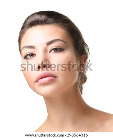 Woman model posing at studio isolated on white. Beauty face closeup portrait.